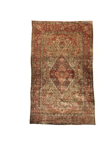 A Mohtashem Kashan silk rug, Central Persia, circa 1890, 209cm x 126cm