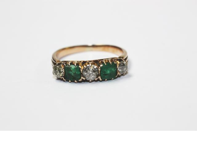 An emerald & diamond five stone ring,