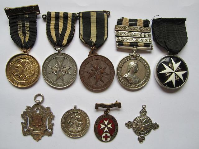 An Order of St.John pair to Sergeant G.Robinson, St.John Ambulance Brigade,