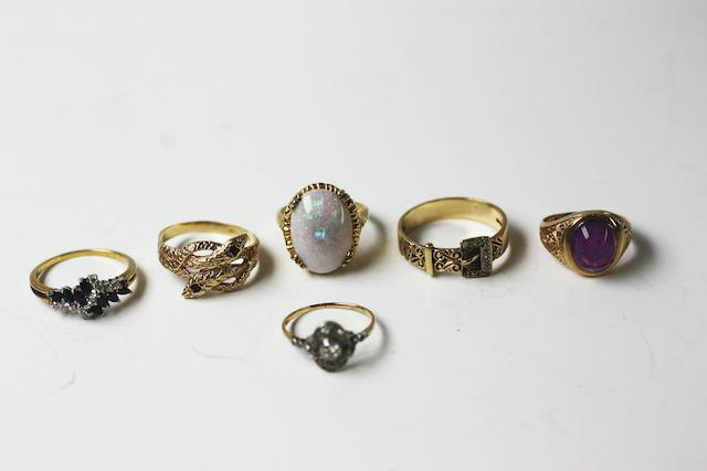 A collection of six assorted rings, (6)