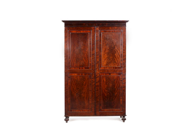 A Regency mahogany and crossbanded Gentleman's wardrobe attributed to Gillows