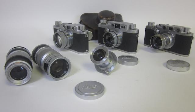Leica: A collection of cameras and lenses including: Leica IIIg, (qty)