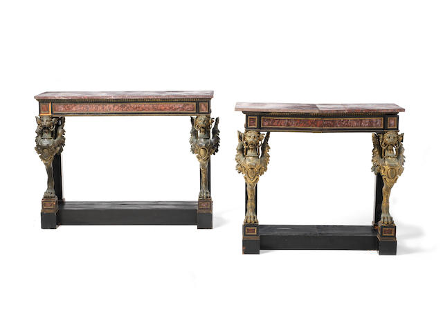 A pair of mid-19th century ebony, rouge griotte marble and gilt bronze mounted console tables in the manner of Louis-Alexandre Bellangé, Paris