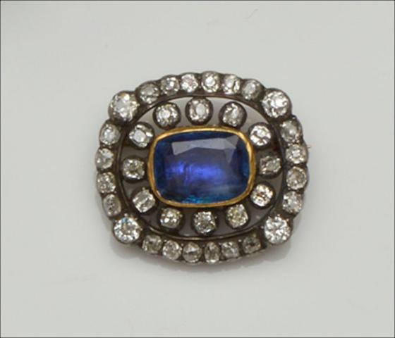 A diamond and sapphire brooch