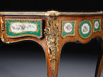 A early Victorian kingwood, tulipwood banded and porcelain mounted serpentine bureau plat attributed to Edward Holmes Baldock