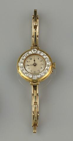 A diamond set lady's wristwatch and a Victorian diamond star brooch (2)