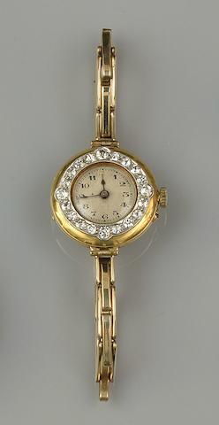 A diamond set lady's wristwatch and a Victorian diamond star brooch (2)