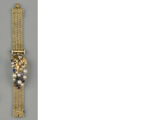 Girard Perregaux: A lady's diamond, sapphire and cultured pearl set bracelet watch
