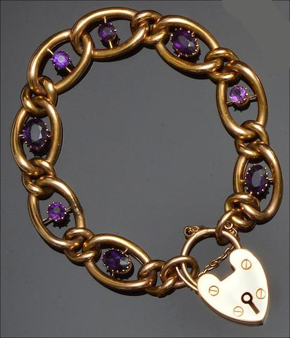 A Victorian gold guard chain with locket, an amethyst bracelet and three bangles (5)