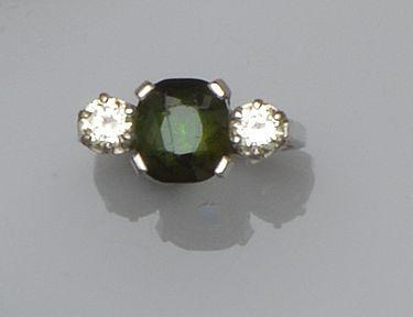 A green tourmaline and diamond three stone ring