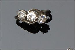 A diamond three stone crossover ring