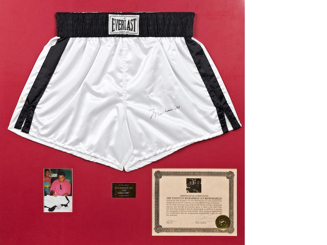Muhammad Ali hand signed boxing trunks presentation