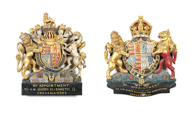 A pair of mid-20th century Royal Warrants for HM Queen Elizabeth II and HM Queen Elizabeth the Queen Mother for Norman Hartnell