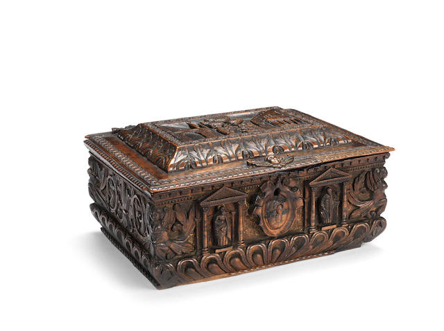 An late 16th/early 17th Italian century carved and parcel-gilt walnut marriage casket or small cassone circa 1600