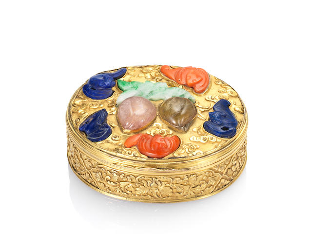 A very fine and rare hardstone-mounted gilt-bronze 'auspicious peaches and bats' oval snuff box and cover Qianlong, circa 1740-1770