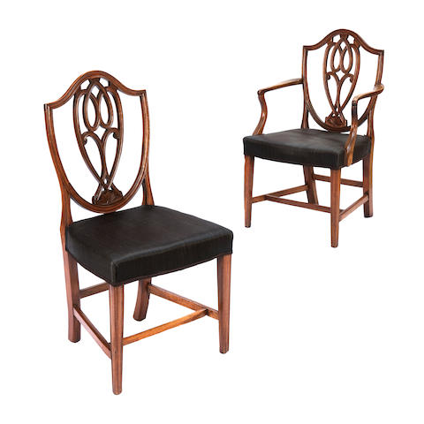 A set of eight George mahogany dining chairs