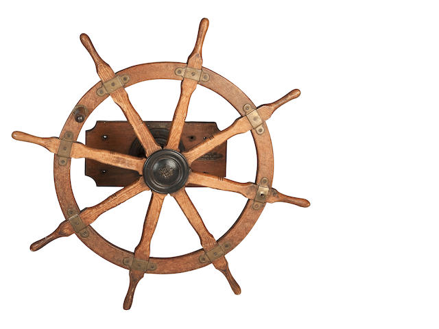 "A late 19th/early 20th century oak ship's wheel 118cm diameter, (46"" diameter)"