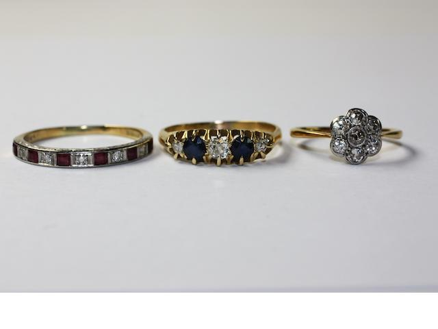 Three gem set rings,