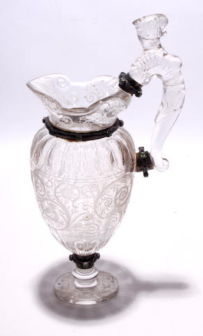 A continental glass ewer with silver mounts,