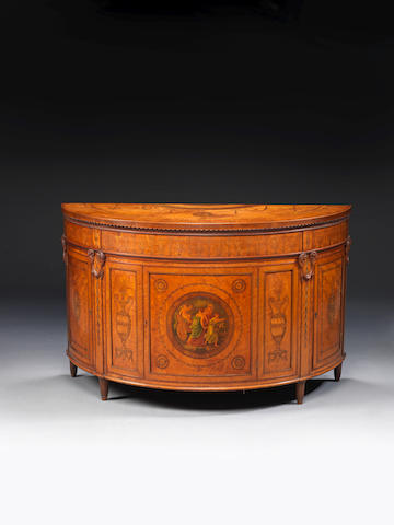 A late Victorian satinwood, tulipwood, harewood, sycamore and polychrome decorated marquetry demi-lune commode in the George III style after a design by Robert Adam
