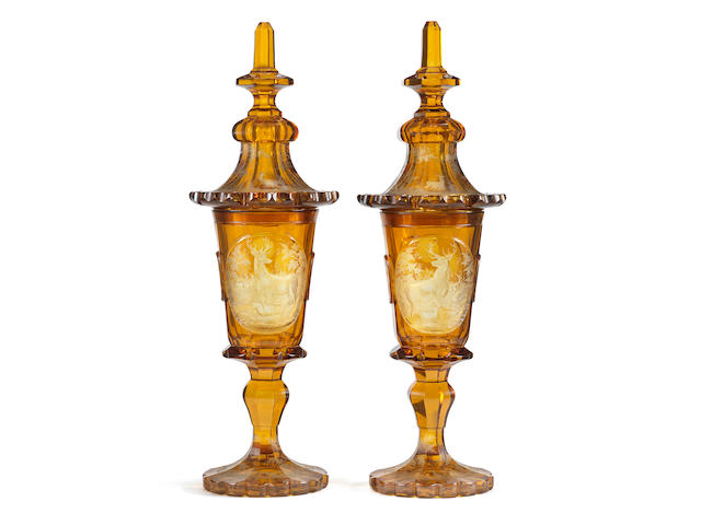 An impressive pair of Bohemian amber-stained goblets and covers, circa 1840-60