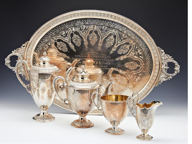 A Victorian silver presentation five piece tea and coffee service by J.W.Benson, Sheffield 1884, 1886, the tray by Martin & Hall, London 1881