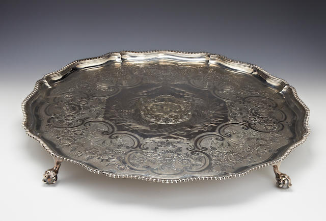 A George III silver large circular salver  by Ebenezer Coker, London 1771