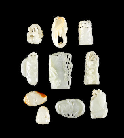 A group of ten small pale celadon jade carvings Qing Dynasty