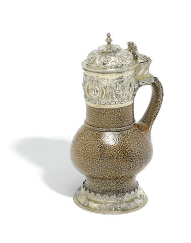 "An Elizabeth I silver-gilt and salt-glazed Rhenish ""Tigerware"" jug maker's mark CB monogram, London 1578"