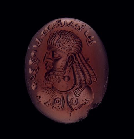 A Sasanian cabochon garnet portrait seal