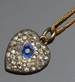 A sapphire and diamond heart-shaped pendant on chain and three rings (4)