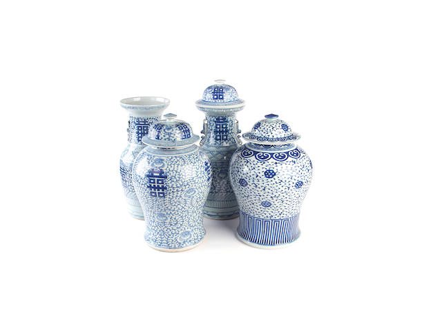 Four large Chinese blue and white vases and three covers