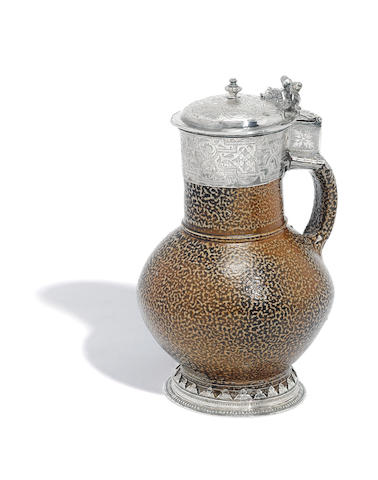 "An Elizabeth I silver mounted and salt-glazed Rhenish ""Tigerware"" jug maker's mark distorted, possibly one over-striking another, London 1561"