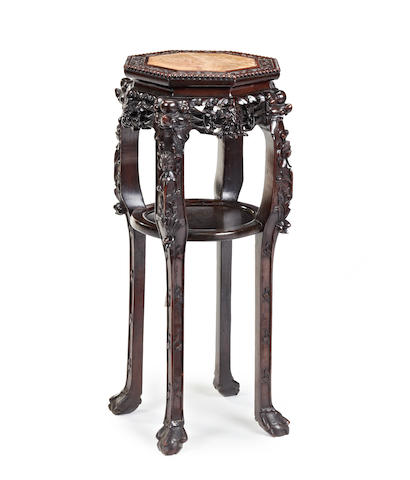 A late 19th/early 20th century carved hardwood Oriental jardiniere stand