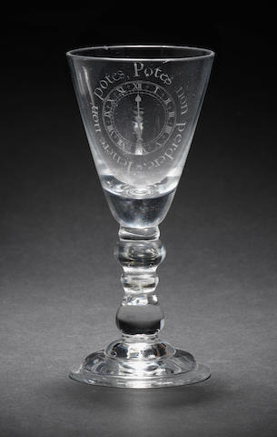 A rare baluster wine glass with diamond point engraving, circa 1720