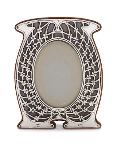 A stylish Edwardian Art Nouveau silver and copper photograph frame by C. Widmer & Sons, London 1910