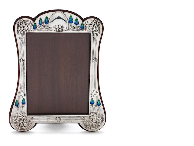 An Edwardian Art Nouveau silver and enamel photograph frame by Lawrence Emmanuel, Birmingham 1903