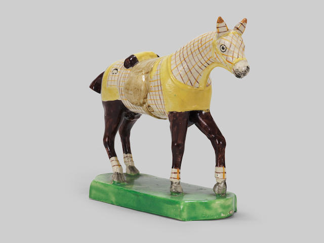A very unusual Staffordshire model of a horse in a training blanket, circa 1810-20