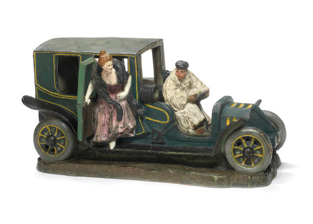A large terracotta sculpture of an Edwardian car, by Salesio,