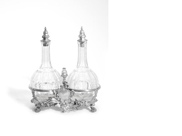 A William IV silver double bottle frame and etched decanters by Robert Garrard (II), stand London 1836, stoppers 1835,