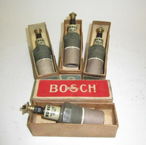 Four Bosch 'V 1218 c' spark plugs,