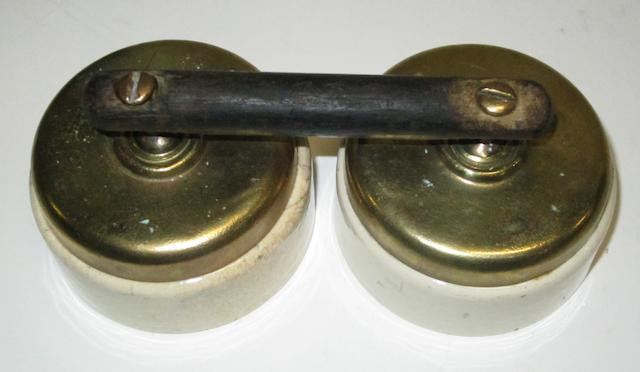 A joined pair of ignition switches by Ediswan,