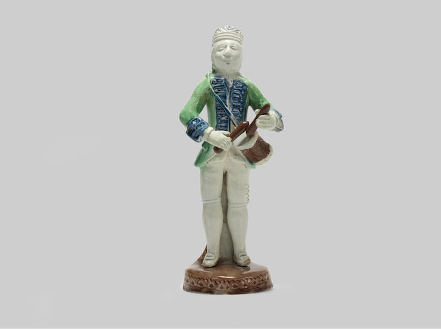 An early Staffordshire figure of a drummer, circa 1770-75
