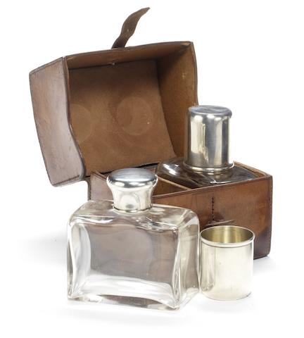 A leather cased travelling drinks set for two persons, 1904,