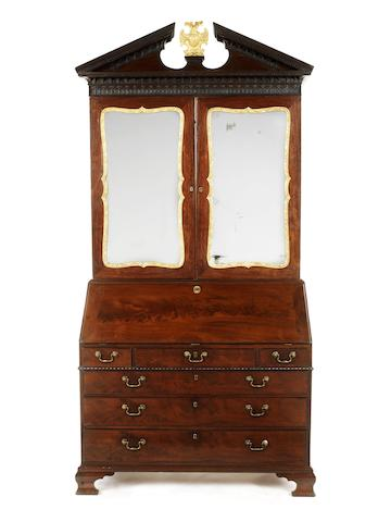 A George III mahogany parcel gilt bureau cabinet attributed to Gillows