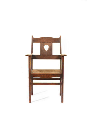 Charles Francis Annesley Voysey (1857-1941) An Oak Arts and Crafts Open Armchair, circa 1905