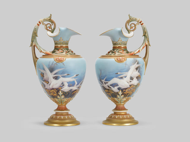 A pair of large Royal Worcester ewers by Charley Baldwyn, dated 1899