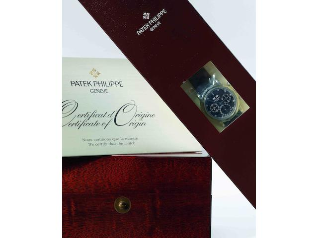 Patek Philippe. A fine and rare PT950 platinum and diamond set perpetual calendar chronograph manual wind wristwatch with moon phasesRef:3970EP, Case No.4225244, Movement No.3047133, Sold in May 2004, STILL SEALED IN ITS ORIGINAL PATEK PHILIPPE PAPER PACKAGING AND PLASTIC