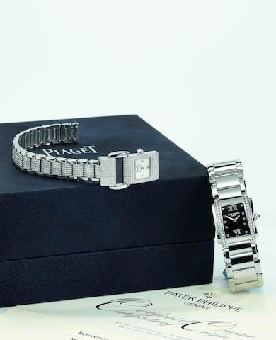 Patek Philippe. A stainless steel and diamond set quartz lady's bracelet watchTwenty-4, Ref:4910/010, Case No.4134905, Sold in September 2001