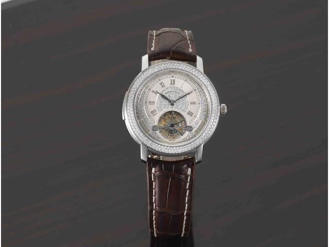 Audemars Piguet. A very rare and important 18ct white gold and diamond set minute repeating tourbillon manual wind wristwatchJules Audemars Minute Repeater Tourbillon, Ref:25982BC, Case No.F10216, Movement No.571205, Recent